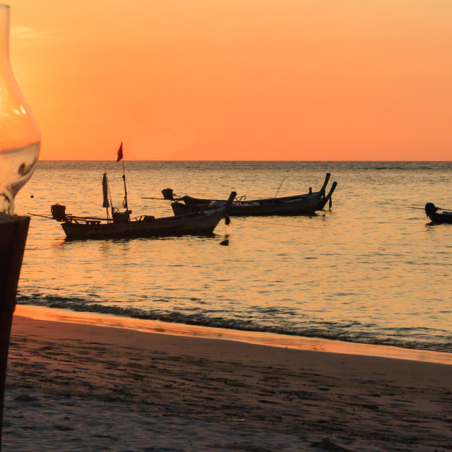 """""""Lamp and fishing boats silhouetted"""" stock image"""