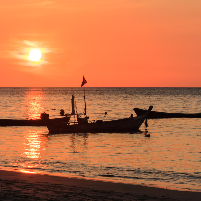 """""""Fisherman silhouetted on his boat"""" stock image"""