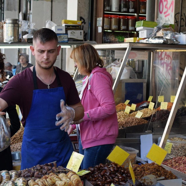 """""""vendors and customers at dried fruit and nuts market"""" stock image"""