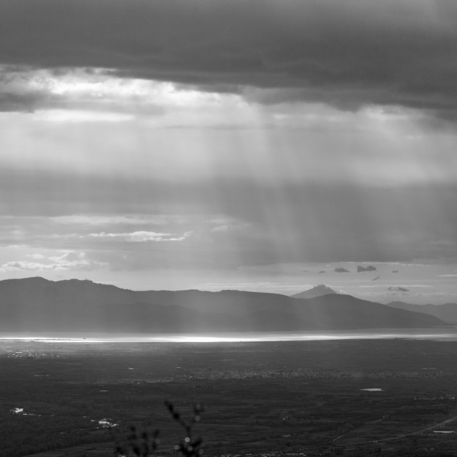 """Sun rays make their way through clouds"" stock image"