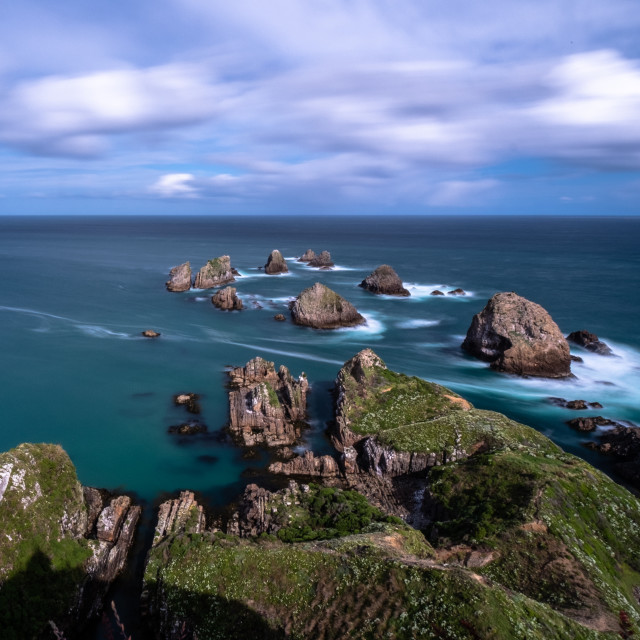 """Long Exposure of rocks at Nugget Point"" stock image"