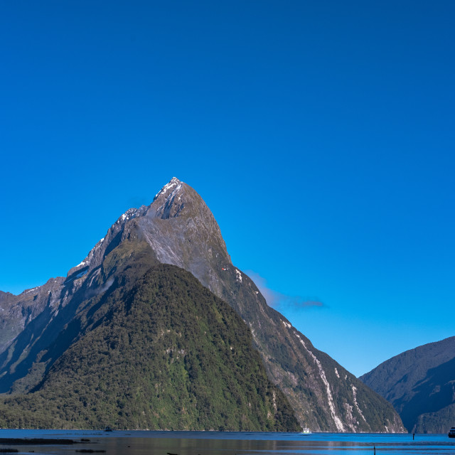 """Perfect blue sky at Milford Sound"" stock image"