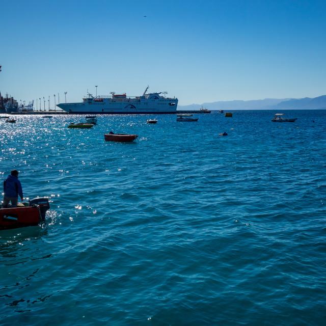 """Aqaba, Jordan, fishermen in small boat"" stock image"