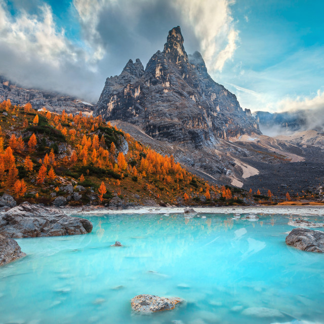 """Autumn alpine landscape with turquoise glacier lake, Sorapis, Dolomites, Italy"" stock image"