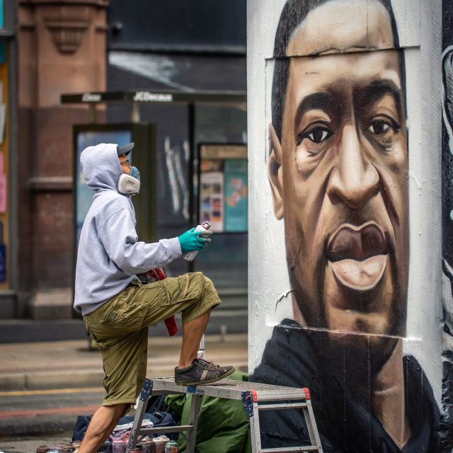 """Graffiti Artist Akse, painting a mural of Floyd George"" stock image"