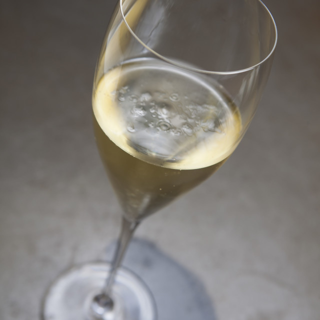 """""""A glass of delicious sparkling wine on concrete surface"""" stock image"""