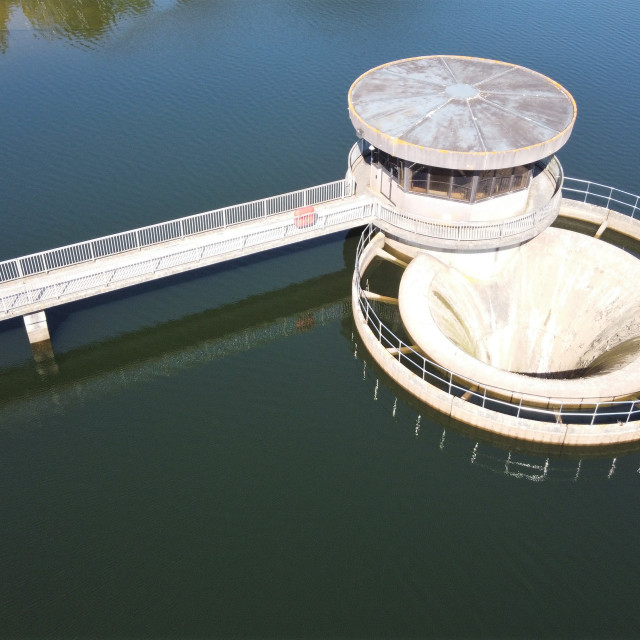 """Reservoir water shaft spillway."" stock image"