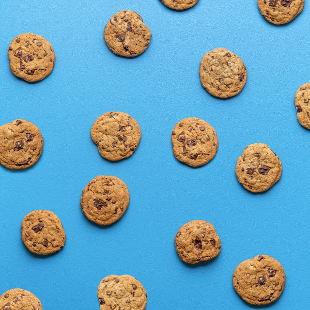 """""""Chocolate chip cookies background. Cookies pattern on blue color"""" stock image"""