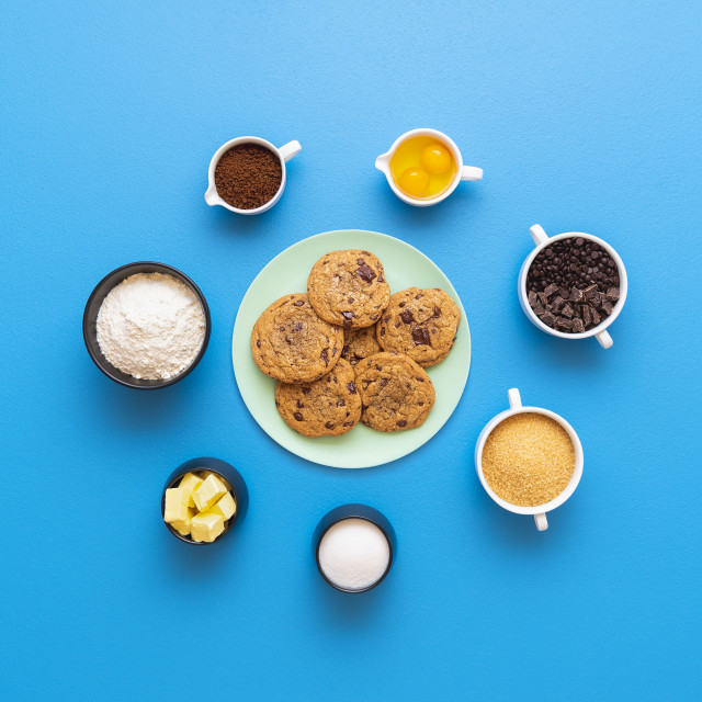 """""""Chocolate chip cookies on a plate and the recipe ingredients"""" stock image"""