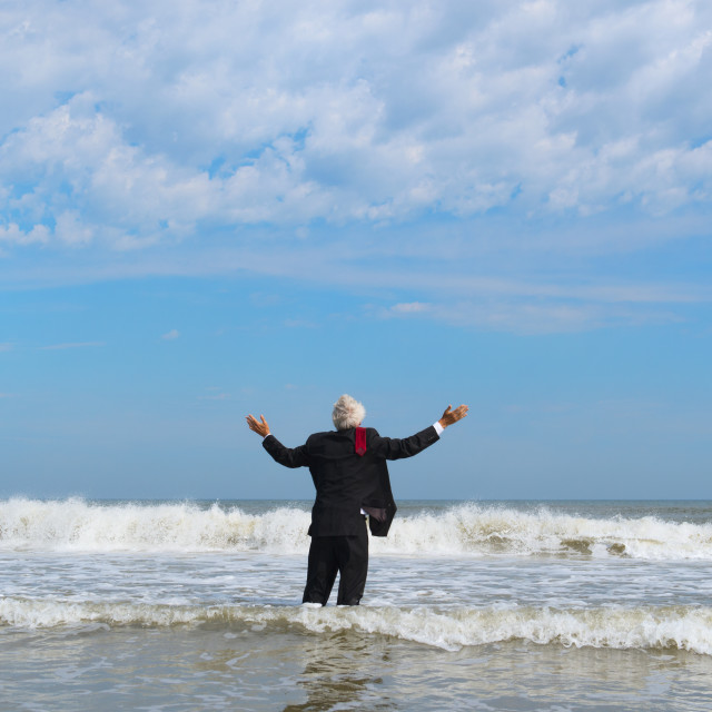 """Business man walking in the sea"" stock image"