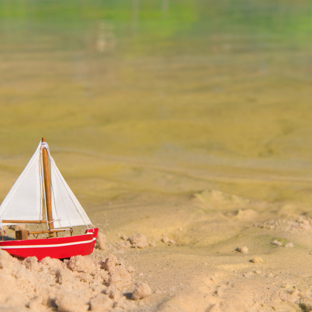 """Miniature sail boat at beach"" stock image"