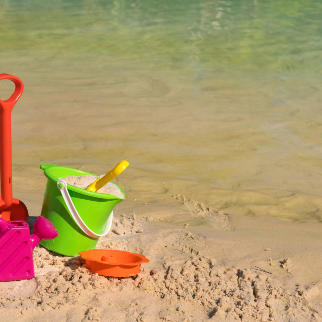 """Plastic toys at the beach"" stock image"