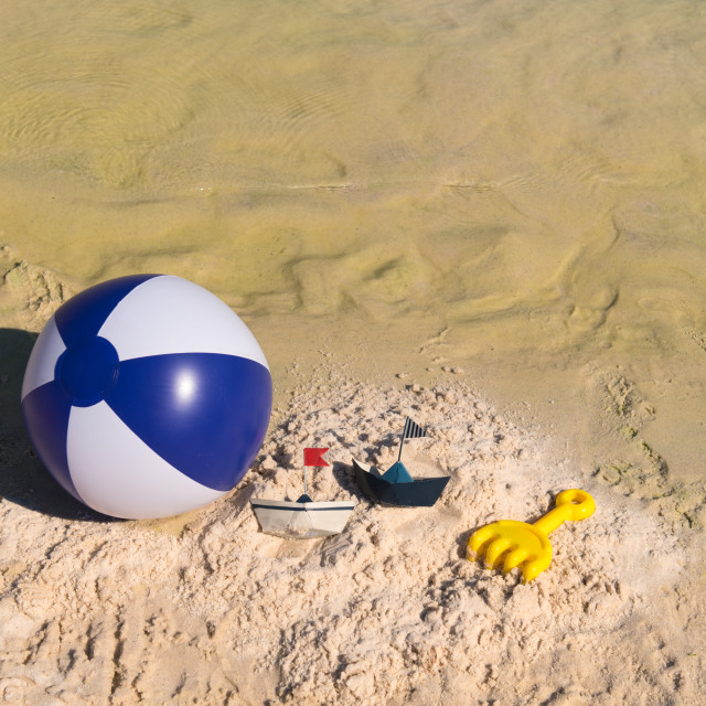 """Several toys at the beach"" stock image"