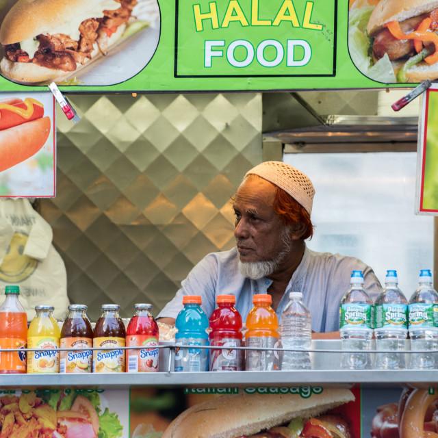 """NEW YORK - USA - 13 JUNE 2015 - Arabic man while selling halal food"" stock image"