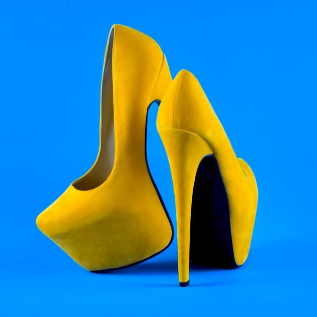 """""""Shoe Stories : Yellow Stilettos On Blue"""" stock image"""