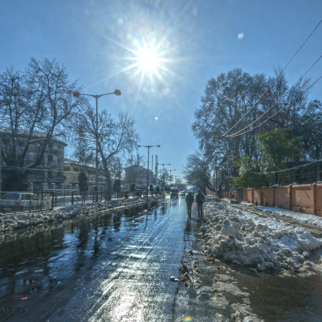 """""""A ROAD FLOODED WITH MELTING SNOW"""" stock image"""