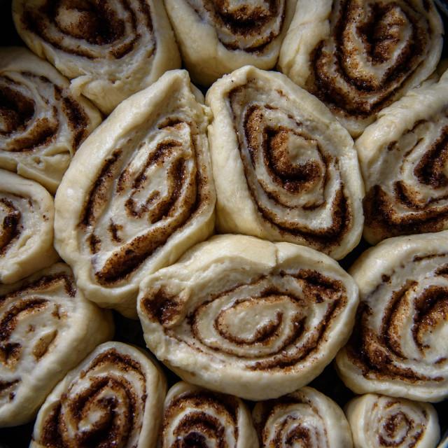 """Cinnamon roll baking. Homemade cake."" stock image"