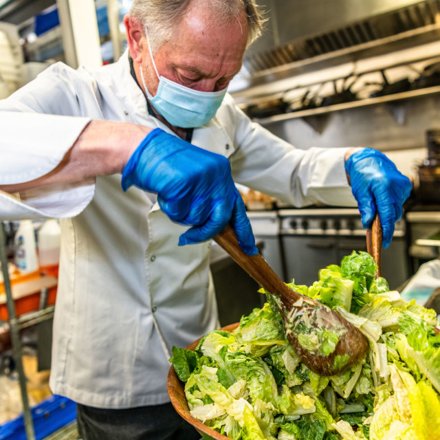 """""""Chef wearing PPE supporting frontline workers by making meals each day"""" stock image"""