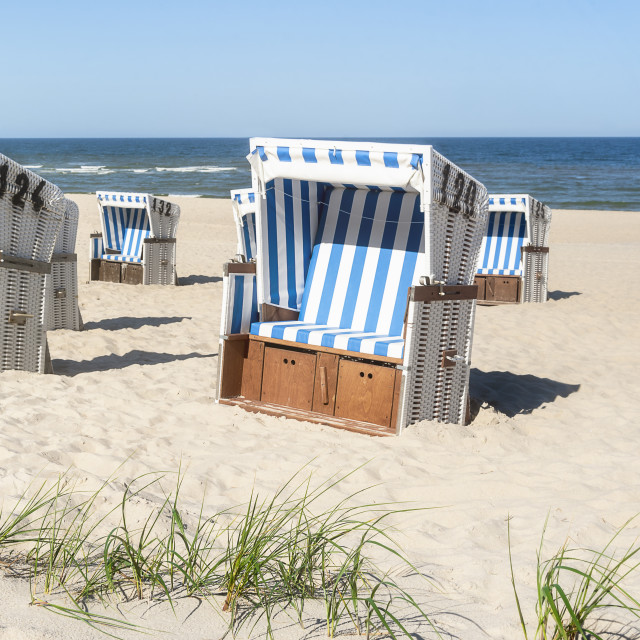 """""""Beach chairs on the sand at the North Sea on Sylt island. Summer vacation"""" stock image"""