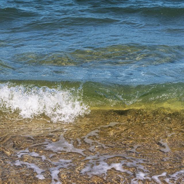 """North sea waves splashing on Sylt island shore. Sea water close-up"" stock image"
