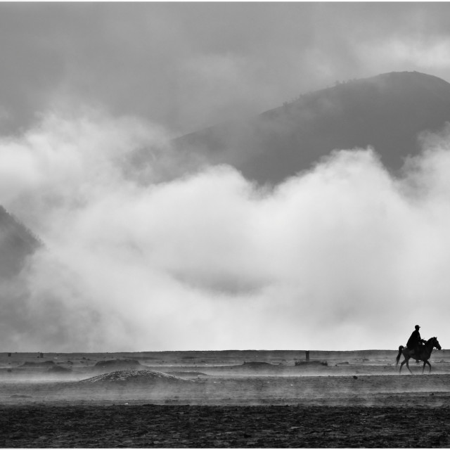 """Cowboy of the Caldera, Bromo"" stock image"