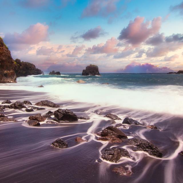 """Sunrise over black sand beach"" stock image"