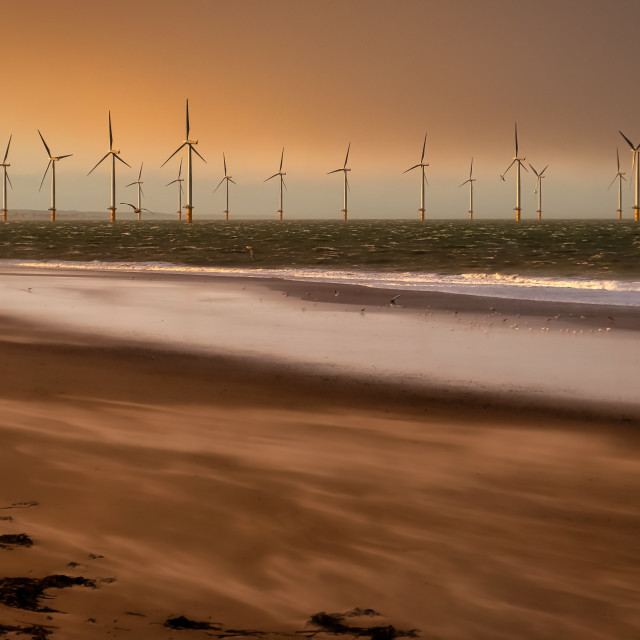 """Soft glow on Redcar sands"" stock image"