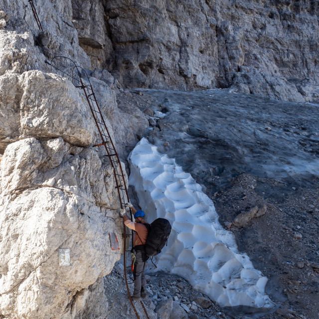 """Male mountain climber on a Via Ferrata in breathtaking landscape"" stock image"