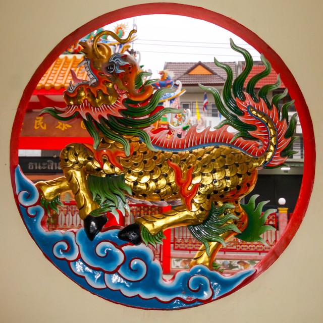 """Dragon in round window"" stock image"