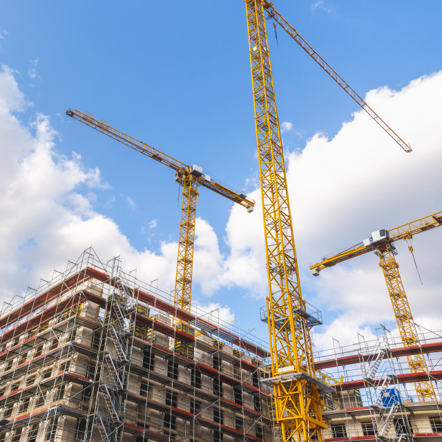 """""""Construction site with yellow cranes"""" stock image"""