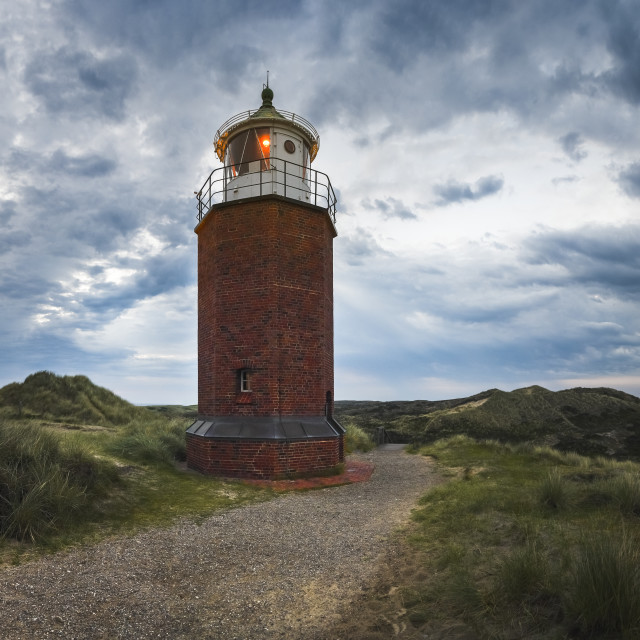 """""""Red Cliff Lighthouse in the evening in Kampen on Sylt island"""" stock image"""