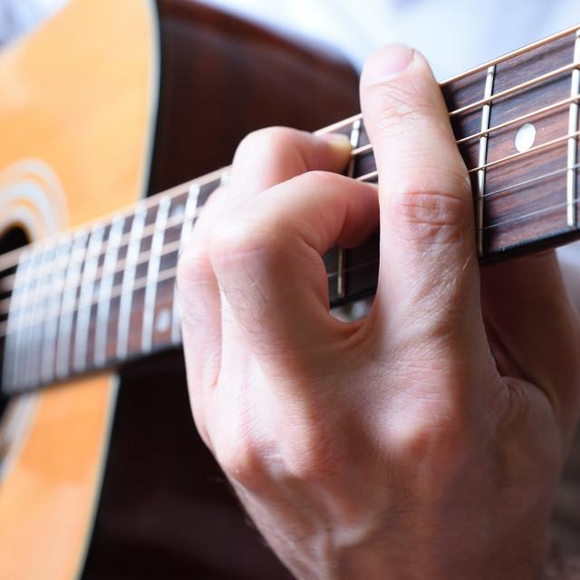 """Detail of man playing acoustic guitar"" stock image"