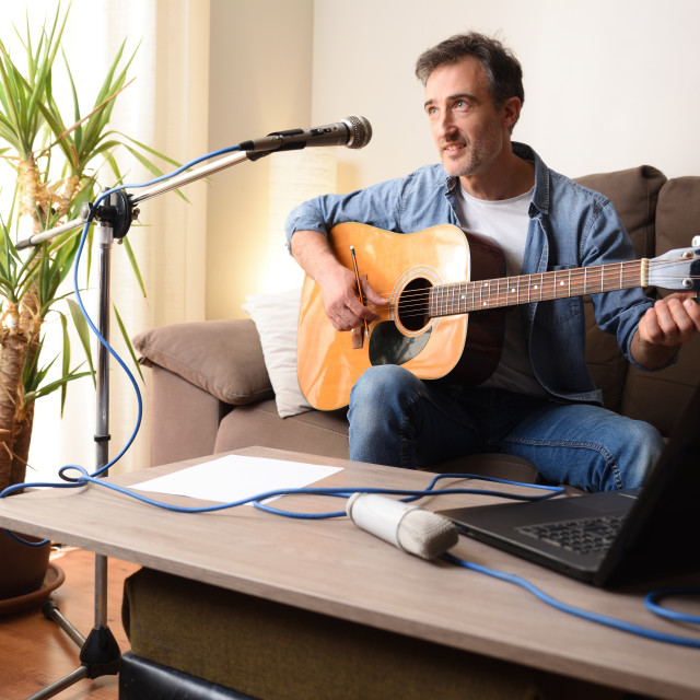 """""""Home recording equipment for music with guitar microphone and laptop"""" stock image"""