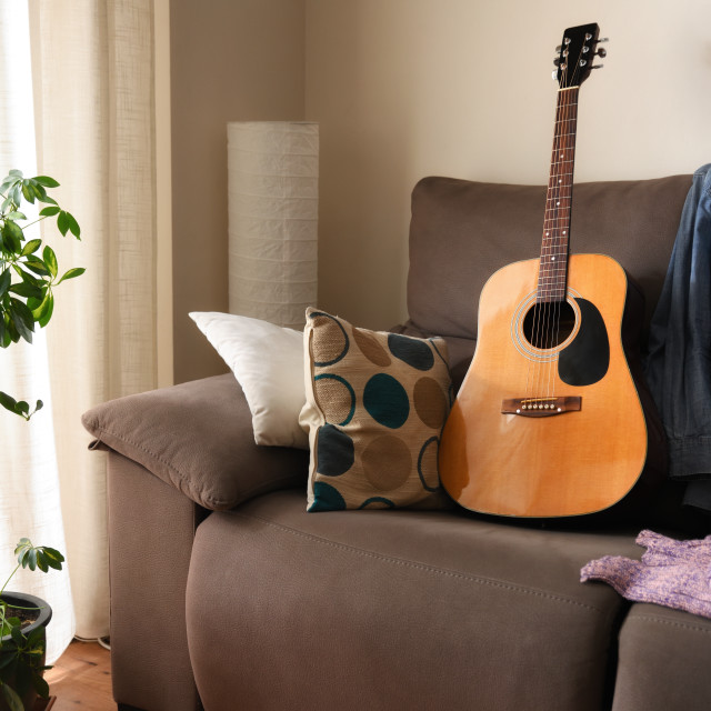 """""""Room with an acoustic guitar on a sofa"""" stock image"""