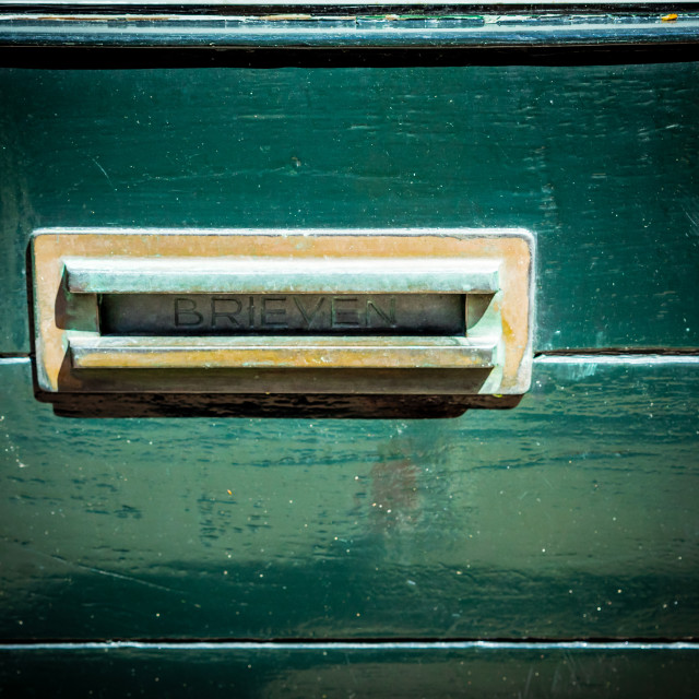 """Ornate letterbox green door"" stock image"