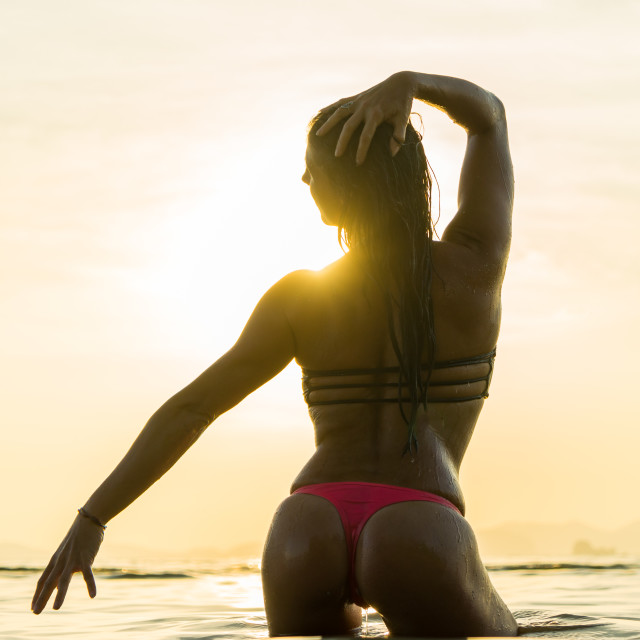 """""""woman on the beach at sunset"""" stock image"""