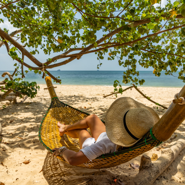"""""""Woman relaxing at the beach"""" stock image"""
