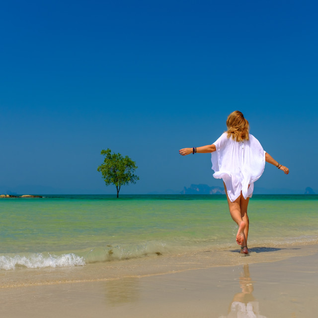 """""""Woman relaxing on the beach in Krabi Thailand"""" stock image"""