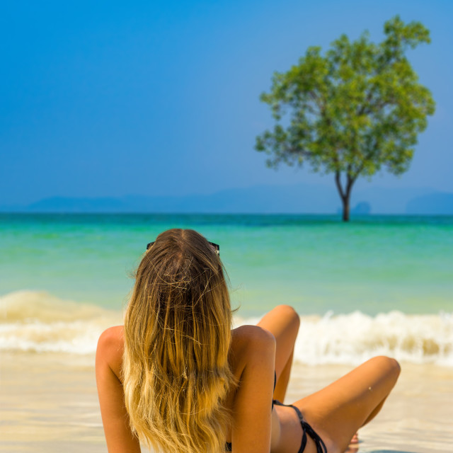 """""""Cute woman relaxing on the summer beach."""" stock image"""