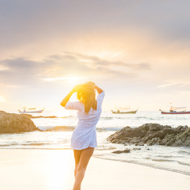 """""""Woman walking on the beach at sunset"""" stock image"""