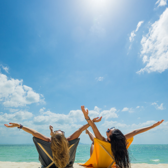 """""""Two Women enjoying their holidays on the tropical beach"""" stock image"""