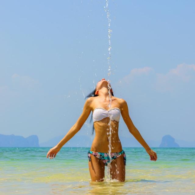 """Beautiful girl splashing water with her hair in the sea."" stock image"