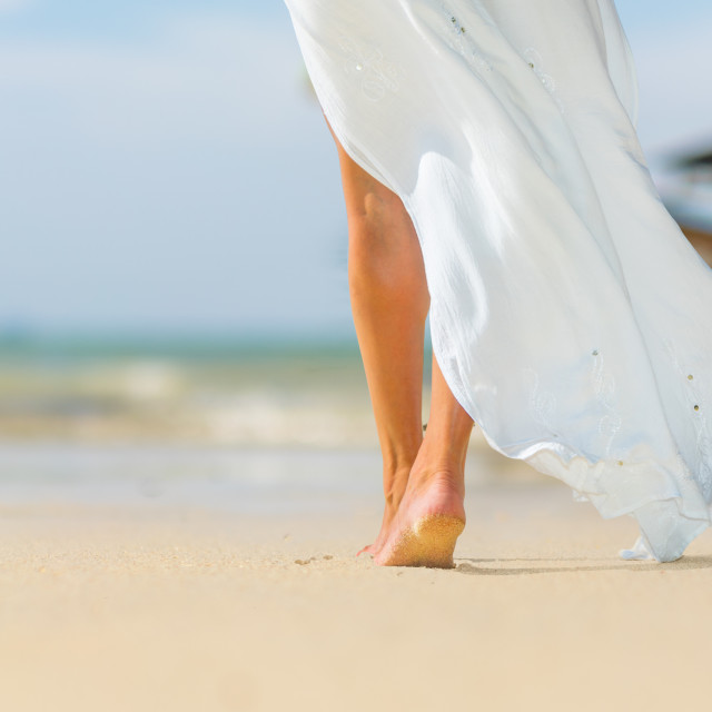 """""""White pareo woman legs walking on tropical beach vacation. Close"""" stock image"""