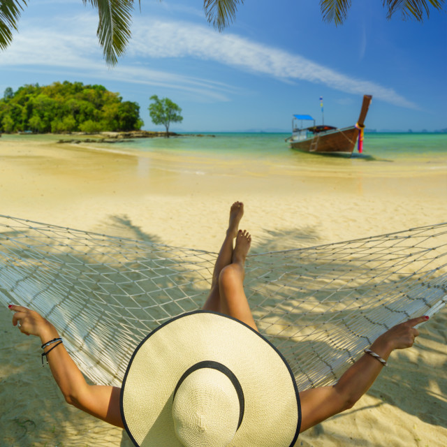 """""""Woman on a hammock at the beach in Thailand"""" stock image"""