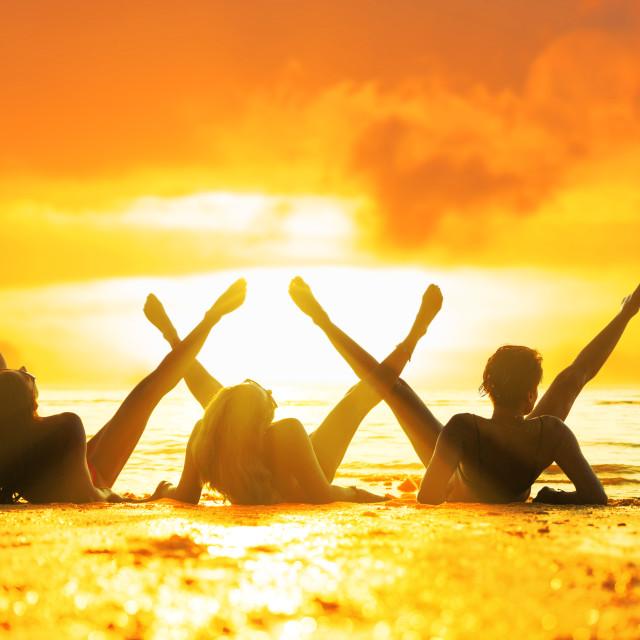 """Silhouette of three girls on the beach"" stock image"