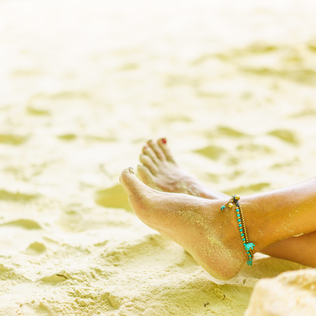 """""""Woman feet leg near beach sand red nails resting and relaxation"""" stock image"""