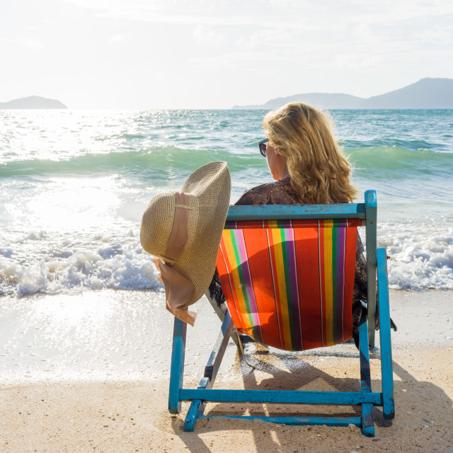 """""""Young woman lying on sun lounger near the sea"""" stock image"""