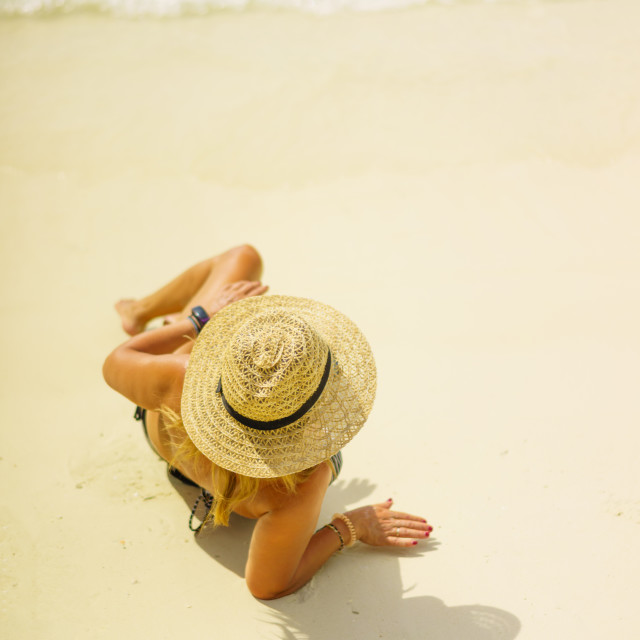"""""""Woman with straw hat at the beach in Thailand"""" stock image"""