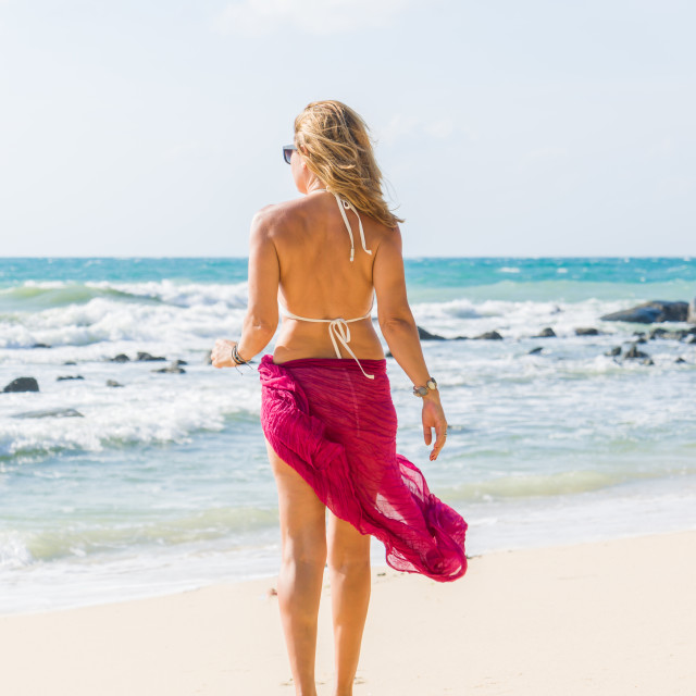 """""""Woman with strw hat at the beach"""" stock image"""