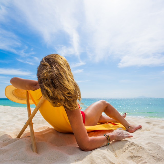 """""""Woman enjoying her holidays on a transat at the tropical beach"""" stock image"""